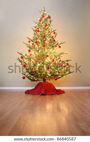 Christmas tree with red ball ornaments - stock photo