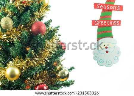 Christmas tree with Santa Claus decoration isolated on white with copy space for text. Seasonal image of decorated fir tree. - stock photo