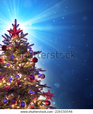 christmas tree with shining blue star  - stock photo