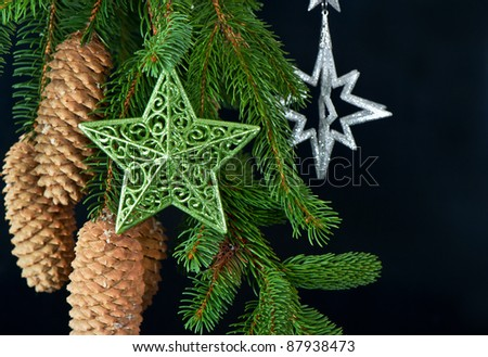 christmas tree with shiny stars decoration over black background - stock photo