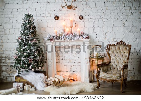 Christmas tree with vintage decorations near fireplace - stock photo