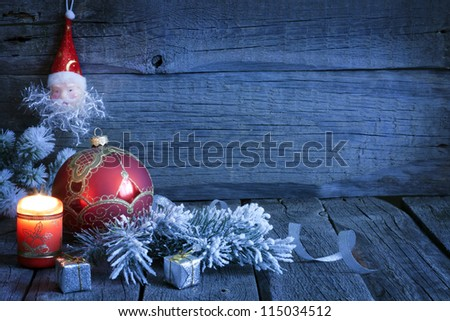 Christmas vintage background with candle and bauble in night - stock photo