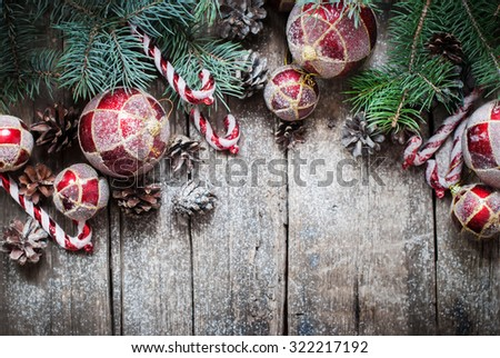 Christmas Vintage Fir Tree Toys, Red Balls, Coniferous, Candy Cane, Pine Cones as Decor on Wooden Planks - stock photo
