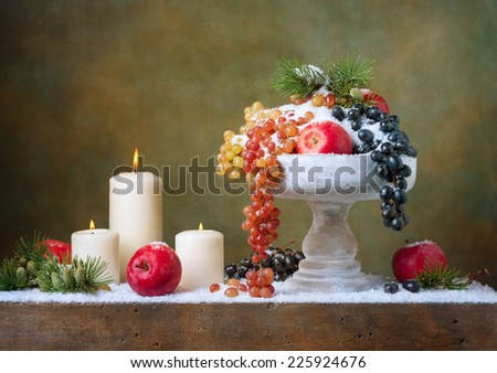 Christmas vintage still life with apples and grapes - stock photo