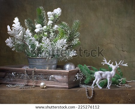 Christmas vintage still life with deer and christmas decorations  - stock photo