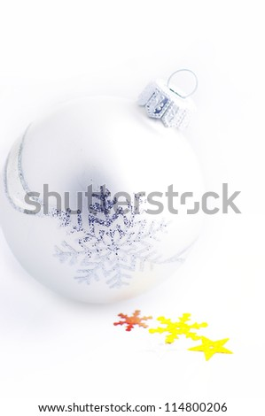 christmas white background, with a christmas balls (selective focus).A white and yellow christmas star and white chrtistmas ball over white background. - stock photo