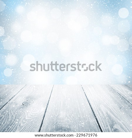 Christmas winter background with wooden table and blurred bokeh - stock photo