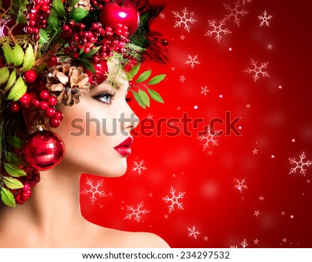 Christmas Winter Woman. Beautiful New Year and Christmas Tree Holiday Hairstyle and Make up. Beauty Fashion Model Girl over holiday red Background. Creative Hair style decorated with Baubles. Makeup - stock photo