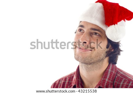 Christmas Wish: Smiling young man with Christmas hat looking up at copyspace, isolated over white background