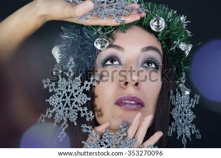 Christmas Woman. Beautiful New Year and Christmas Tree Holiday Hairstyle and Make up