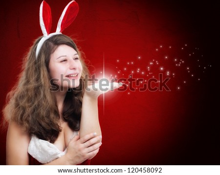 Christmas Woman blowing some stars on red background - stock photo