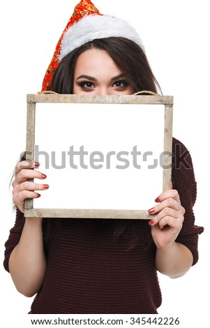 Christmas woman hold big white card. . Santa hat. Isolated smiling girl. Snow-white smile. card covers everything except the eyes - stock photo