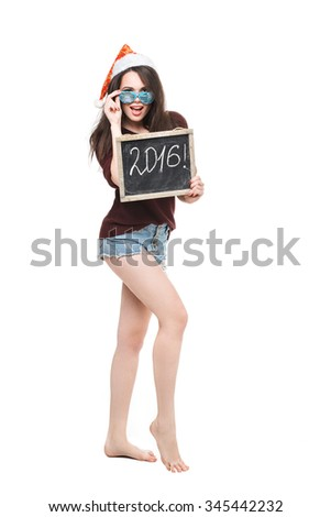 Christmas woman hold card with the word of 2016. Santa hat. Isolated smiling girl.  Snow-white smile - stock photo