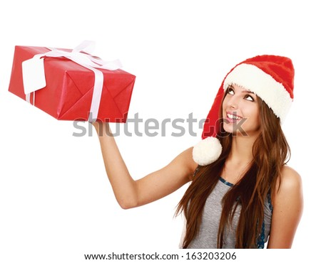 Christmas woman holding gift wearing Santa hat. Isolated on white background
