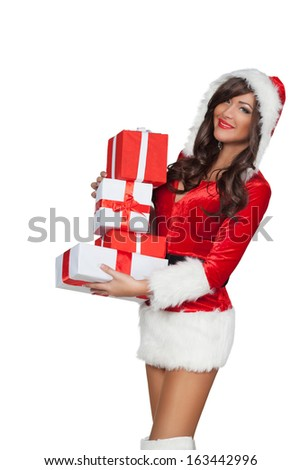 Christmas woman holding gifts wearing red Santa costume, isolated - stock photo