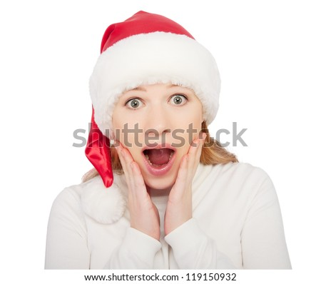 Christmas woman in a hat shock, surprise isolated on white background