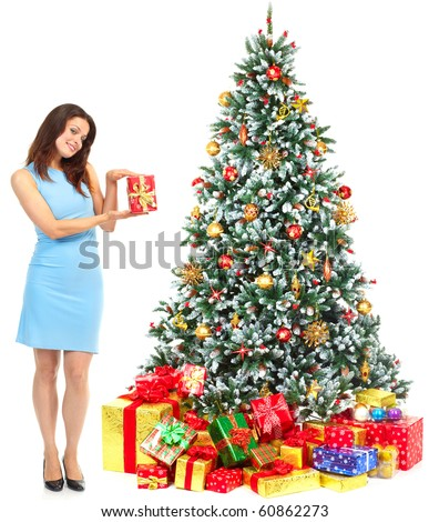 Christmas woman near a Christmas tree. Isolated over white background - stock photo