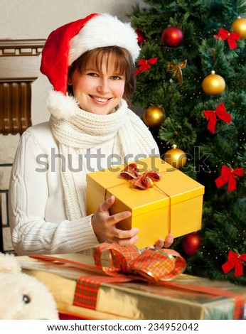Christmas Woman. New Year and Christmas Tree santa claus hat. - stock photo