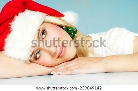 Christmas Woman. New Year. Santa claus hat. Winter season. - stock photo