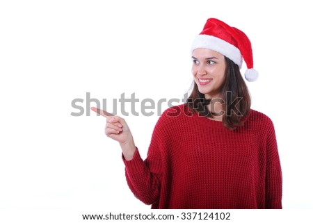 christmas  woman pointing up isolated on white background. - stock photo