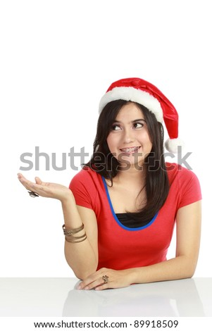 Christmas woman showing something with her hand. Isolated over white background - stock photo