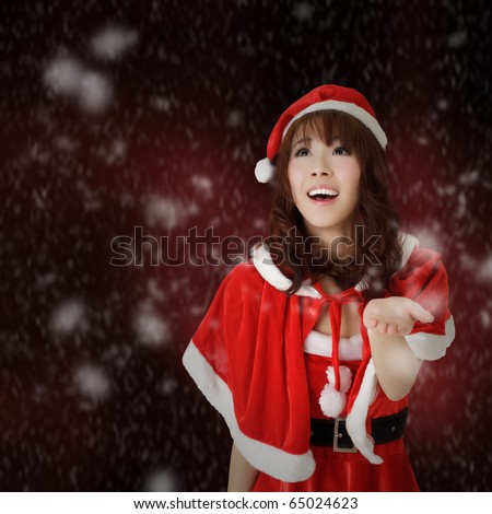 Christmas woman smiling and looking with snowflakes over red background. - stock photo