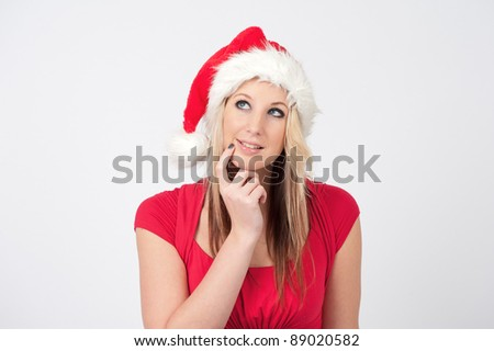 Christmas woman wearing a Santa hat smiling - isolated over a white background - stock photo