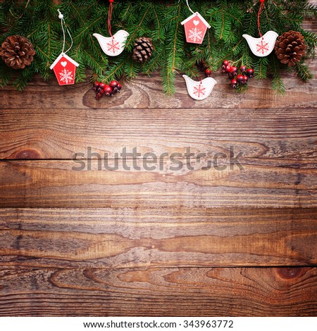 Christmas wooden background with birds fir tree and decor with copy space - stock photo