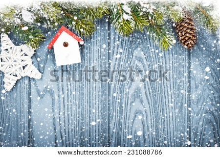 Christmas wooden background with snow fir tree, decor and copy space - stock photo