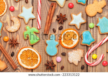 Christmas wooden background with spices and gingerbread cookies - stock photo