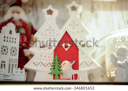 christmas wooden decoration on shelf house with deer  - stock photo