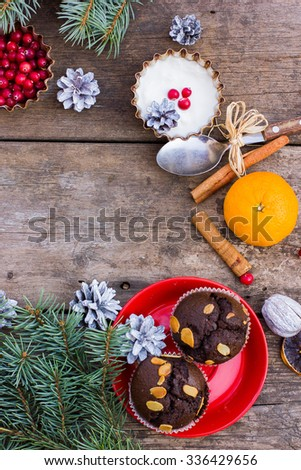 Christmas wooden table covered with a tablecloth on it tablecloth, muffins, tea