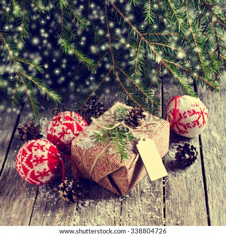 Christmas wrapped gifts on the background of fir branches and snow