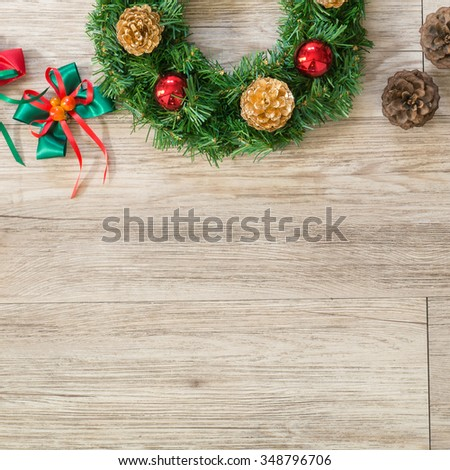 Christmas wreath and ribbon bow on wooden background ( Composition and space for text ) - stock photo