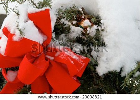 Christmas wreath covered in snow