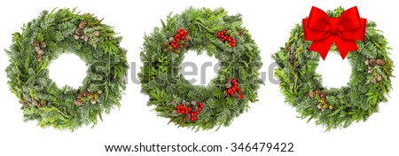 Christmas wreath from fir, pine, spruce twigs with cones and red berries and ribbon bow isolated on white background - stock photo