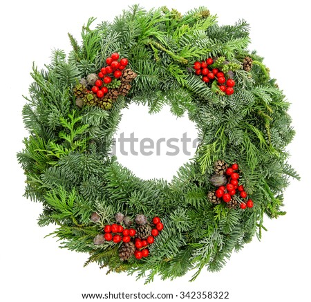 Christmas wreath from fir, pine, spruce twigs with cones and red berries isolated on white background. Festive decoration - stock photo