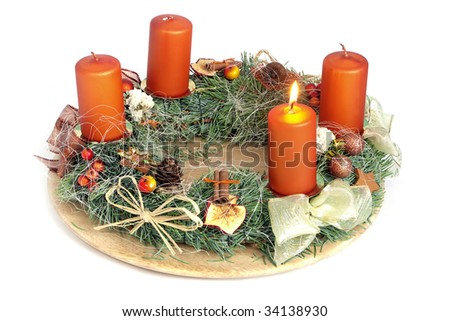Christmas - wreath from fresh twigs and cones with four candle - stock photo