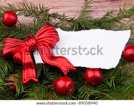 Christmas wreath made from fresh spruce branch and red ornaments on old wooden background - stock photo