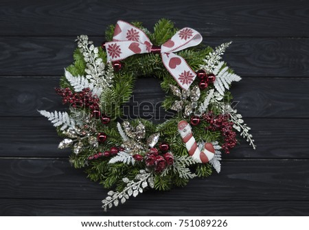Christmas wreath on a black wooden background