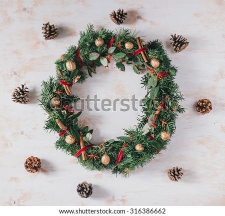 Christmas wreath on a white vintage wooden background - stock photo