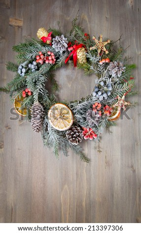 Christmas wreath on a wooden Background - stock photo