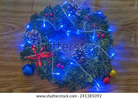 Christmas wreath on a wooden background Christmas decorations red ribbon garlands