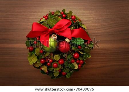 Christmas wreath on the wood door - stock photo