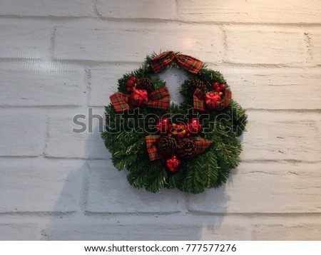 christmas wreath on white wall