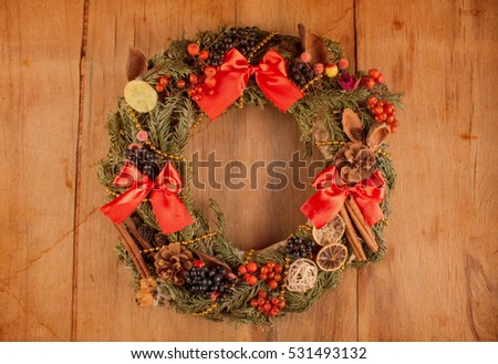 Christmas wreath on wood board. Christmas decoration. Home decoration