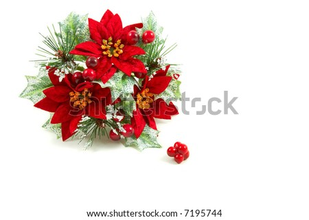 Christmas wreath, poinsettia flowers, leaves and berries on a snowy setup. Horizontal, landscape orientation - stock photo