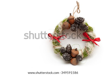 Christmas wreath with acorns, pine cones and red bows. isolated on white background. space for inscriptions. - stock photo