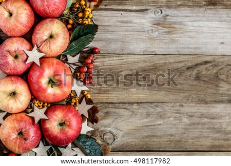 Christmas wreath with apples, berries and leaves. Apple frame. Copy space, top view