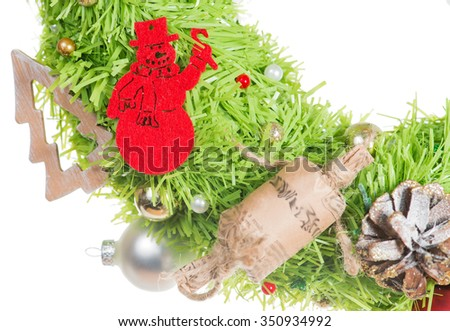 Christmas wreath with Christmas wreath with decorative snowman, cones and candy (shallow DOF), isolated on white background - stock photo